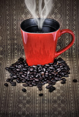 Grunge red coffee mug and beans