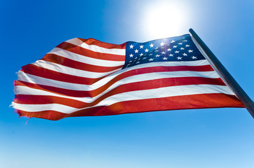 American flag in the clear blue sky