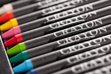 Colorful crayons in a row