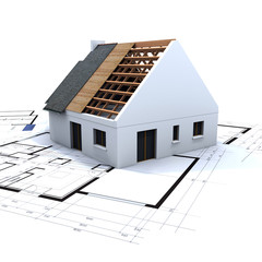 House in construction and blueprints