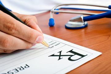 Doctor writing a rx prescription