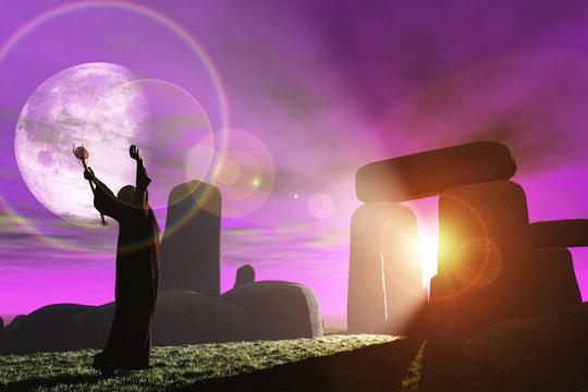 Druid greets the dawn at Stonehenge