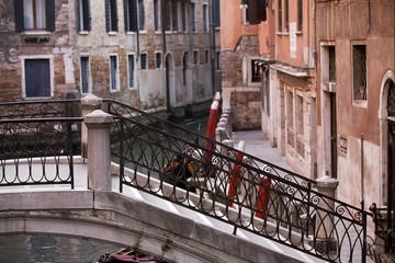 Old bridge over venetian canal