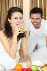Couple enjoying breakfast in bed