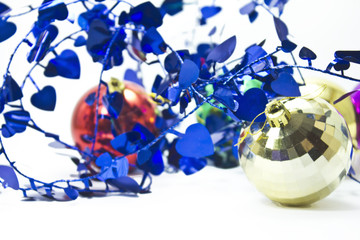 Colored Christmas balls and curly ribbon