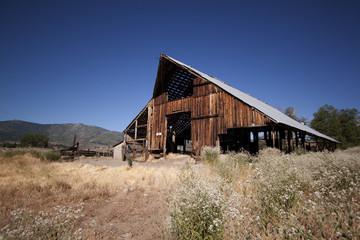 Old barn house with a blue clear sky