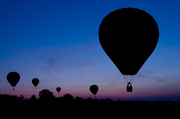Silhouette of the balloon on a sunset background.