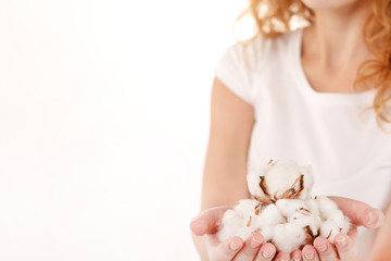 young woman with cotton flowers