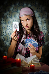 Fortune-teller predicing the cards