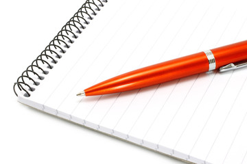 Notepad with orange ball pen on a white background