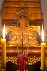 Buddha image behind burning joss stick