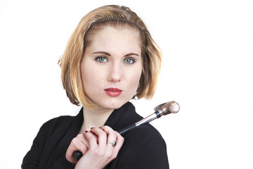 Young blond woman holding up a hammer