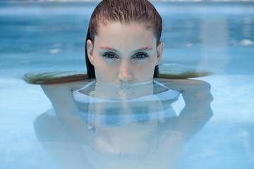 Beautiful woman in the swimming pool