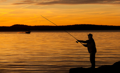 A fisherman in sunset.