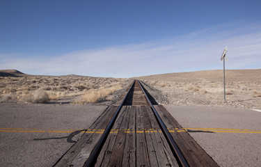 Railroad crossing tracks in the desert