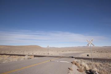 Railroad crossing tracks in the desert