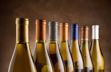 Wall Mural - White wine bottles lined up in a row