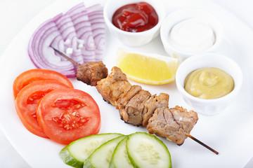 Pork shashlik with fresh vegetables