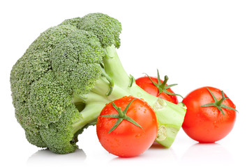 Broccoli and Three Tomato with drops Isolated on white backgroun