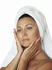 portrait of nice girl without make up in towel