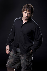 Muscular male in a black shirt posing