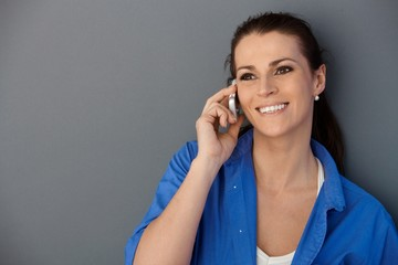 Happy mid-adult woman on phone call