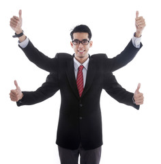 Businessman with four hands showing thumbs up