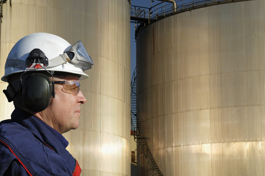 engineer in close-ups and oil refinery