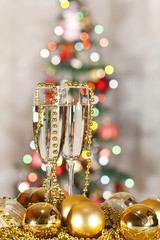 two glasses of champagne and Christmas tree