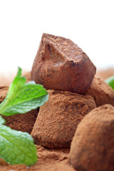 Chocolate truffle with fresh mint dusted with cocoa powder
