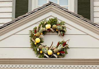 Traditional xmas wreath above front door