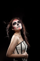 Depressed Young woman in day of the dead mask