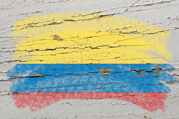 flag of columbia on grunge wooden texture painted with chalk