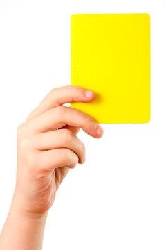 Gelbe Karte in der Hand