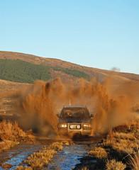 4wd  making huge splash in mud