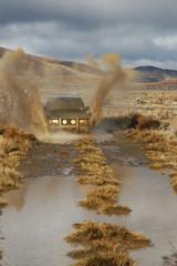 4wd creating big splash in mud
