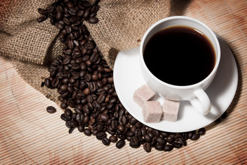 Сoffee beans and a cup