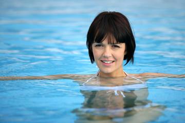 Attractive brunette in pool