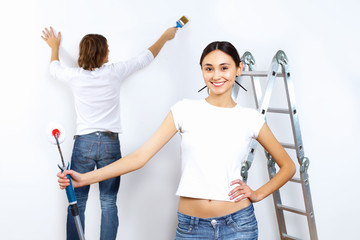 Young couple with paint brushes together