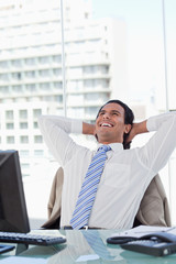 Portrait of a delighted businessman relaxing