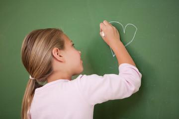 Schoolgirl drawing a heart