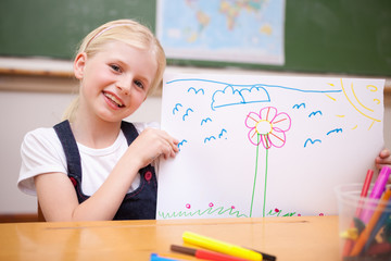 Smiling girl showing her drawing