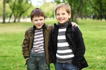 Boy with a friend in the green park
