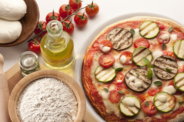 still life with pizza and ingredients