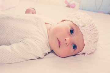 Portrait of baby girl wearing pink hat