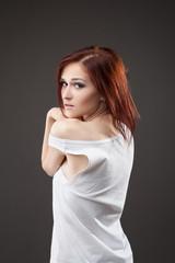 Beautiful sexy young woman undress tank top