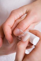 Manicurist acriling client's nails