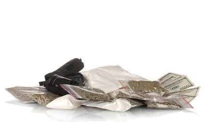 Сocaine and marijuana in packet with gun isolated on white