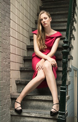 Pretty blond woman in red dress
