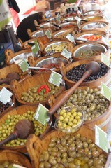 Olives in wooden buckets on sale in market